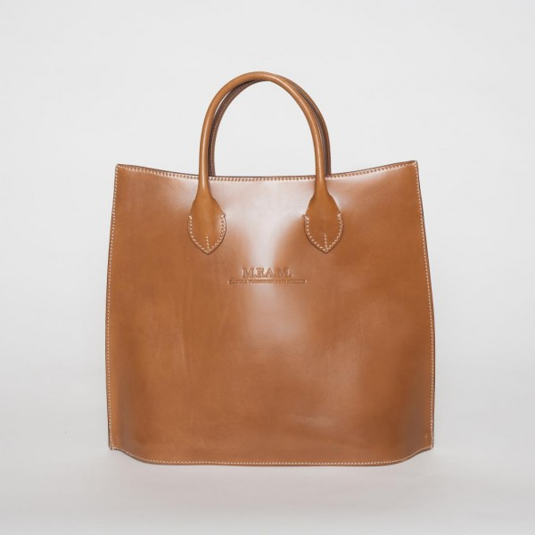 This large capacity leather tote looks even better in person than it does in the product pictures. Made in a rich deep mahogany colored pebble grain leather, the bag is accented with black highlights that make it stand out from the ordinary and give it a more unique designer look.